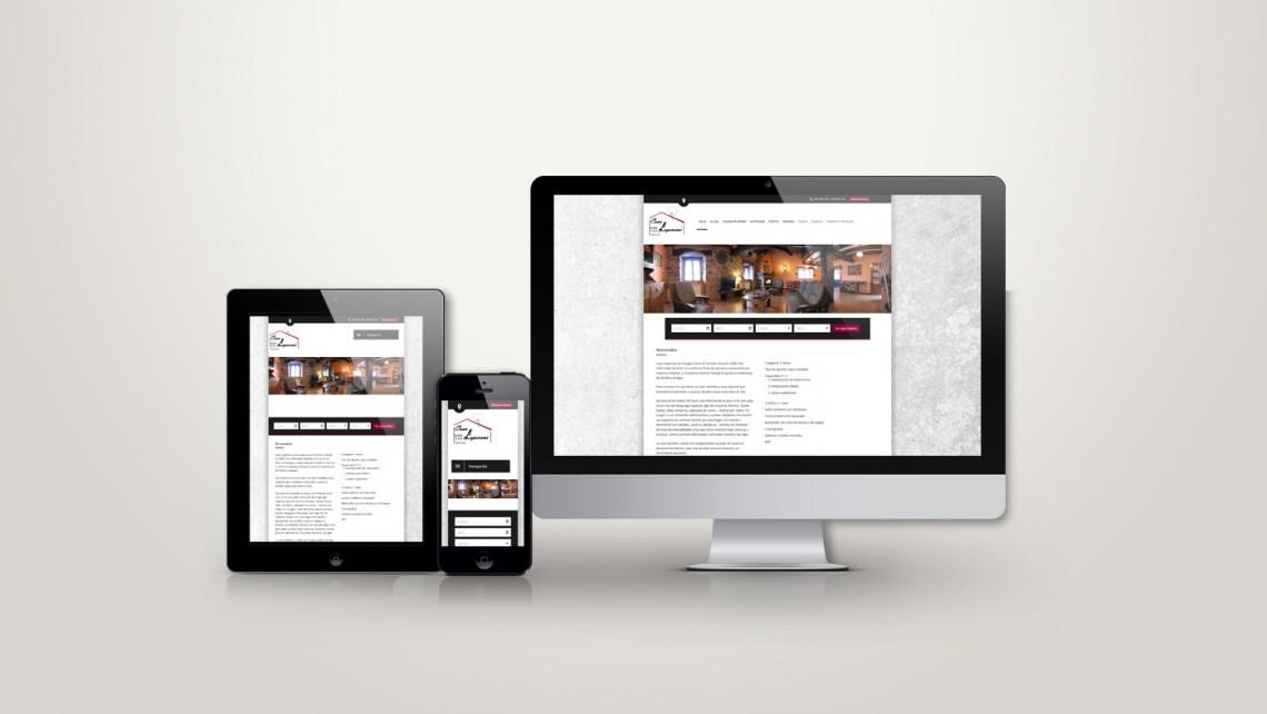 Web responsive de Casa Loperena vista en tres pantallas, tablet, móvil y ordenador