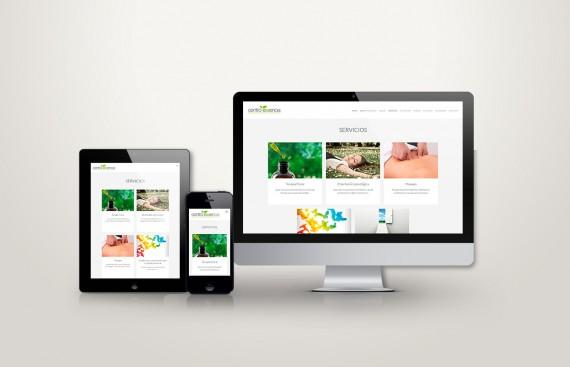 web responsive de centro essencia vista en tres pantallas, tablet, móvil y ordenador