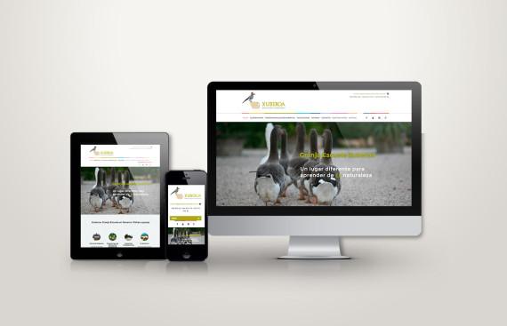 web responsive de granja xuberoa vista en tres pantallas, tablet, móvil y ordenador